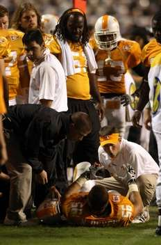 An injured Nick Reveiz is attended to by the Vol staff late in the 3rd Quarter. The Tennessean Photo by Larry McCormack.