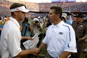 Head coaches Lane Kiffin and Urban Meyer shake hands at the end in Gainesville. AP Photo by John Raoux.