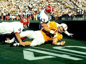 Ronnie Juggins (43) and Happy Dicks (57) tackle an unidentified Vol in the famous 1968 game. Happy Dicks?