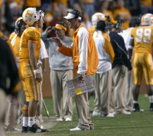 Lane Kiffin coaches Jonathan Crompton after a tough evening against Auburn. Photo by Amy Smotherman Burgess.