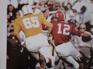 A Vol lineman chases after Tide QB Joe Namath in 1962.