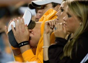 Head in hands says it all for the frustrated faithful. Photo by Joe Howell.