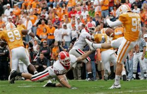 Georgia's Zach Renner gets through the Vol line to block Chad Cunningham's punt for a safety. AP Photo/Wade Payne.