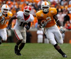 A hobnail boot given back to Georgia: Vol RB Montario Hardesty scampers for a 39 yard TD to keep Georgia at arm's length. AP Photo/Wade Payne.
