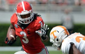 Georgia Bulldogs running back Todd Gurley tries to elude the tackle of Tennessee Volunteers linebacker Jalen Reeves-Maybin during the second quarter at Sanford Stadium Saturday September 27, 2014. BRANT SANDERLIN / BSANDERLIN@AJC.COM