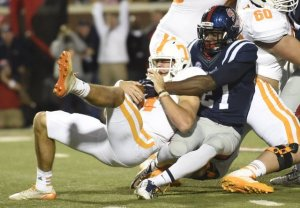 An all too familiar pose of Tennessee's quarterback Saturday night at Ole Miss.