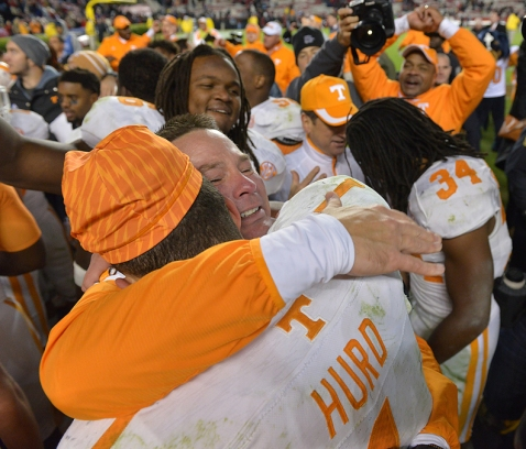 Tennessee coach Butch Jones hugs running back Jalen Hurd (1) after their 45-42 win in overtime against South Carolina in Williams-Brice Stadium Saturday, Nov. 1, 2014 in Columbia, S.C.  (MICHAEL PATRICK/NEWS SENTINEL)